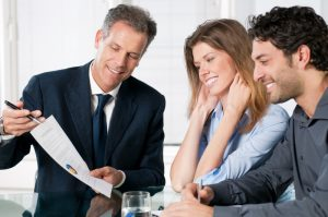 Advisor consulting with clients, Advantage One